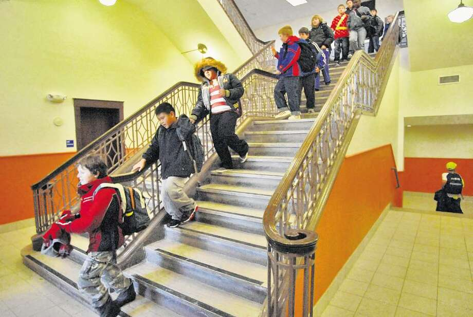 Students head for the door at the refurbished New Scotland Elementary School in Albany. The district is looking at ways to cope with the growth of charter schools. (Phil Kamrass/Times Union) Photo: PHILIP KAMRASS / 00001924A