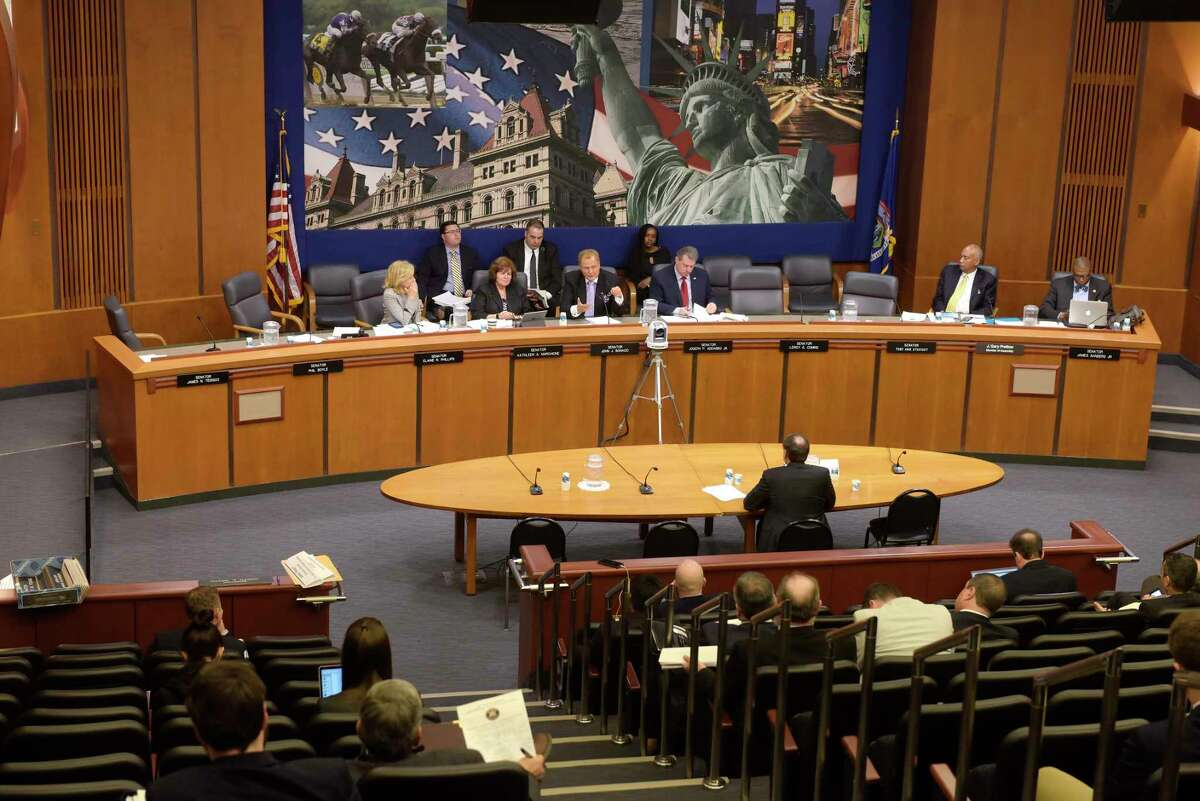 Joseph Asher, CEO of William Hill Race and Sports Book, testifies at a public hearing to consider the potential for sports betting in New York State held by the New York State Senate Committee on Racing, Gaming and Wagering on Wednesday, Jan. 24, 2018, in Albany, N.Y. (Paul Buckowski/Times Union)