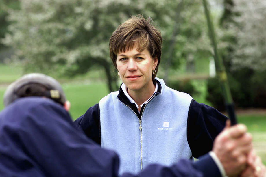 Suzy Whaley, the teaching pro at Blue Fox Run Golf Club in Avon, Conn., gives a lesson to Brett Turner of Newington, Conn., at the golf course's driving range and golf school on April 25, 2002. Whaley, 35, became the first woman to qualify for a PGA Tour event, earning an exemption to next year's Greater Hartford Open by winning a PGA Section Championship Tuesday, Sept. 17, 2002. (AP Photo/The Hartford Courant, John Long)  Photo: JOHN LONG, AP / THE HARTFORD COURANT