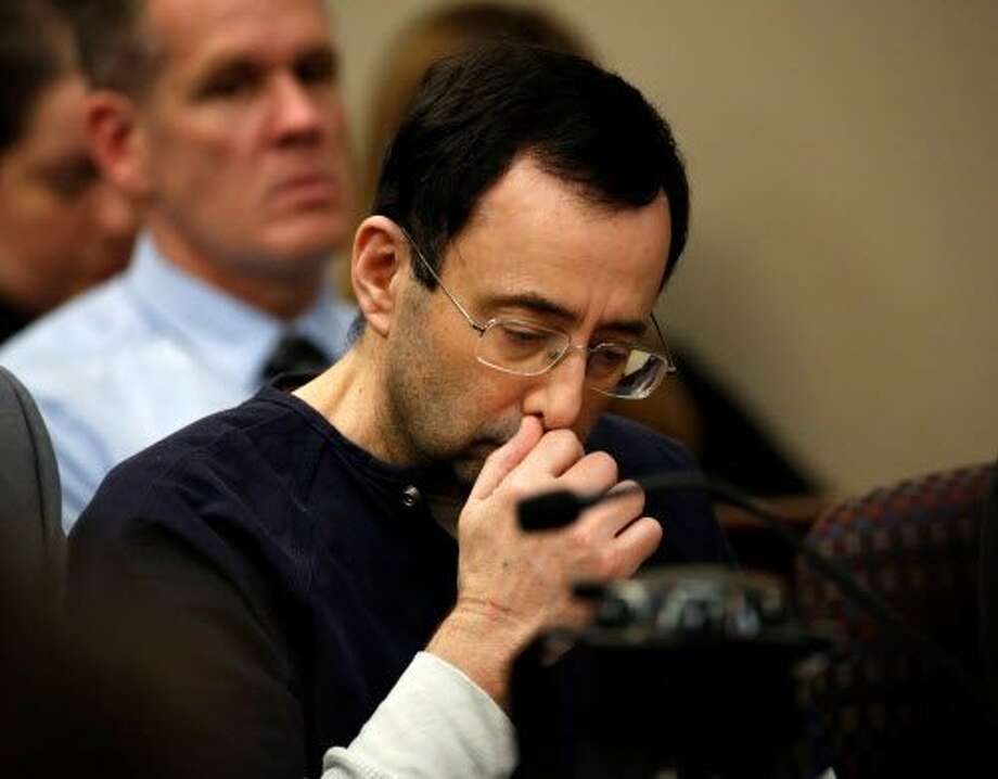 """Former Michigan State University and USA Gymnastics doctor Larry Nassar addresses the court during the sentencing phase in Ingham County Circuit Court on January 24, 2018 in Lansing, Michigan.  Disgraced former USA Gymnastics doctor Larry Nassar was sentenced to 40 to 175 years in prison on Wednesday for sexually abusing scores of young girls under the guise of medical treatment. """"I've just signed your death warrant,"""" Judge Rosemarie Aquilina said as she handed down the sentence after a week of gut-wrenching testimony by over 150 of Nassar's victims.  / AFP PHOTO / JEFF KOWALSKYJEFF KOWALSKY/AFP/Getty Images Photo: JEFF KOWALSKY, AFP/Getty Images"""