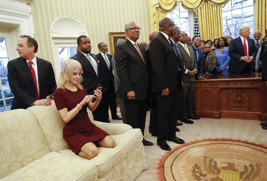 In a photo that sparked controversy early in President Donald Trump's term, Kellyanne Conway kneels on a couch as Trump meets with HBCU leaders. Photo: Pablo Martinez Monsivais, Associated Press