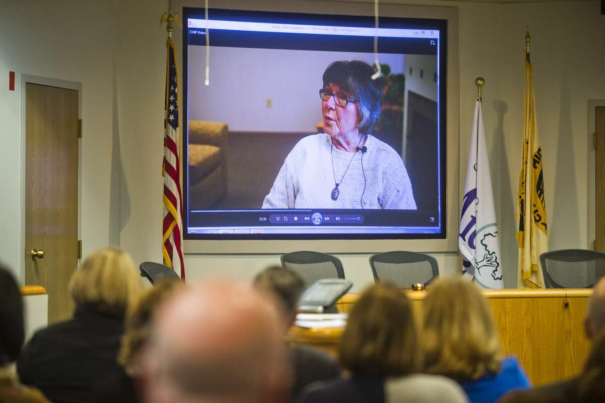 A crowd watches a video update on the Community Health Improvement Plan on Wednesday, Jan. 24, 2018 in the City Council Chambers at City Hall. (Katy Kildee/kkildee@mdn.net)