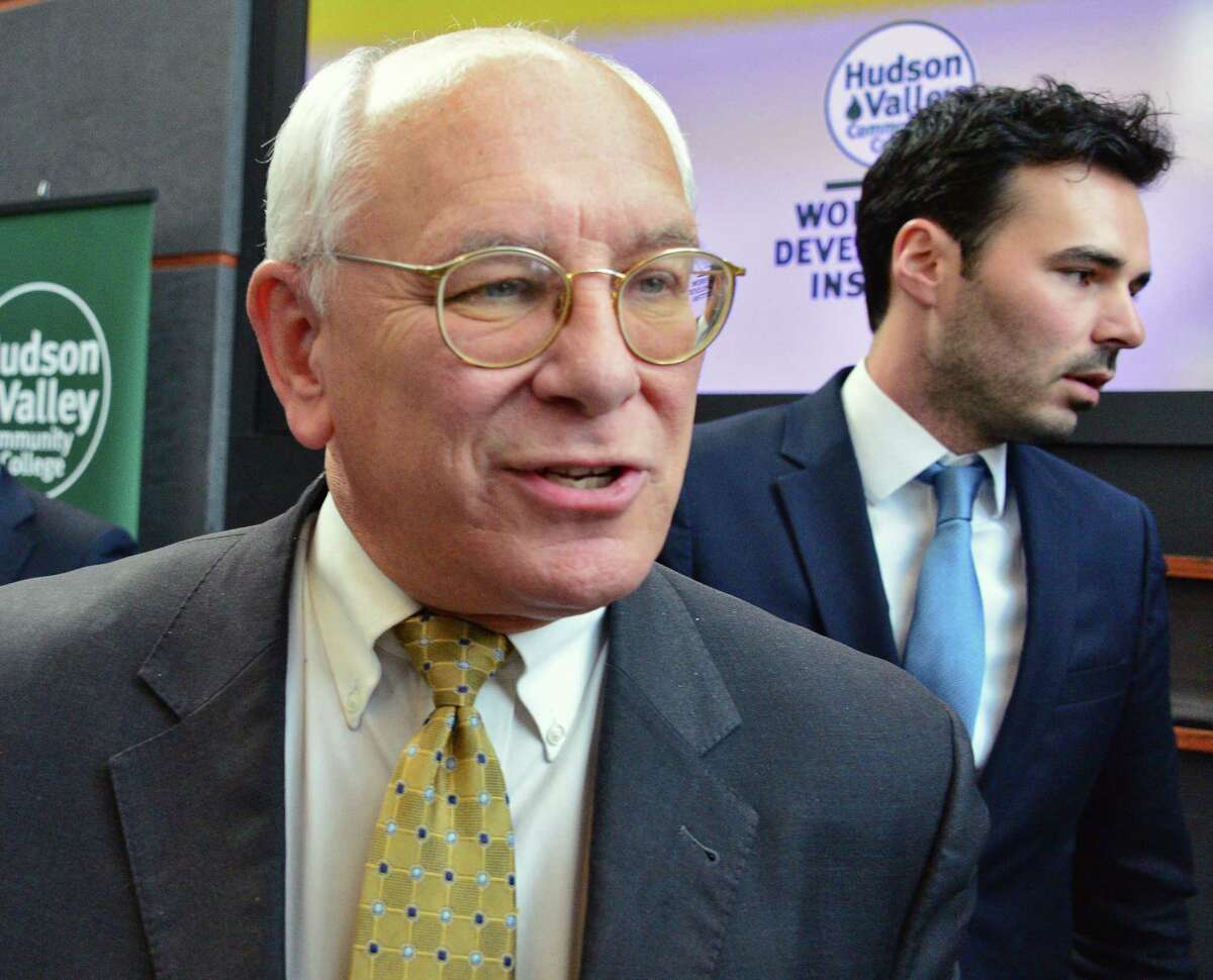 Congressman Paul Tonko, left, and Cypress Creek Renewables's Cameron Bard speak with reporters following the announcement of a partnership between Cypress Creek Renewables's and HVCC to launch a new solar job training initiative Wednesday Jan. 24, 2018 in Troy, NY. (John Carl D'Annibale/Times Union)