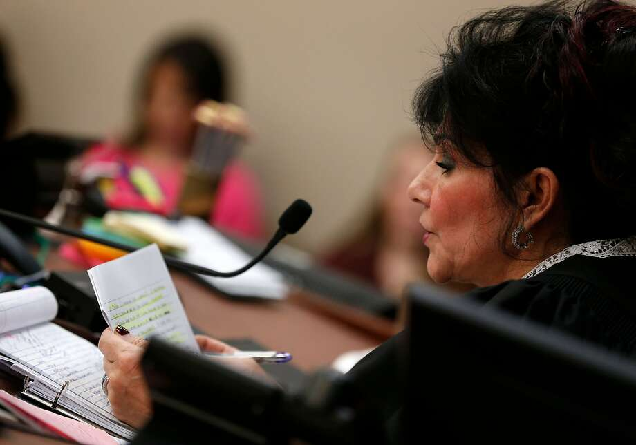 """Judge Rosemarie Aquilina reads a letter from former Michigan State University and USA Gymnastics doctor Larry Nassar during the sentencing phase in Ingham County Circuit Court on January 24, 2018 in Lansing, Michigan. Disgraced former USA Gymnastics doctor Larry Nassar was sentenced to 40 to 175 years in prison on Wednesday for sexually abusing scores of young girls under the guise of medical treatment. """"I've just signed your death warrant,"""" Judge Rosemarie Aquilina said as she handed down the sentence after a week of gut-wrenching testimony by over 150 of Nassar's victims.  / AFP PHOTO / JEFF KOWALSKYJEFF KOWALSKY/AFP/Getty Images Photo: JEFF KOWALSKY, AFP/Getty Images"""