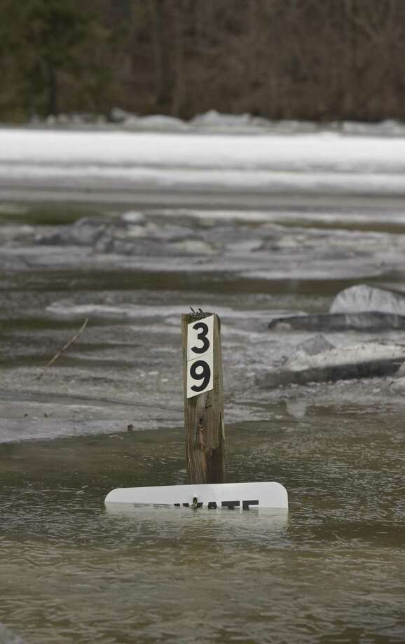 A mail box post is covered with water south of downtown Kent, Conn, on Wednesday morning. The ice jammed Housatonic River sent water across Route 7. January 24, 2018. Photo: H John Voorhees III / Hearst Connecticut Media / The News-Times
