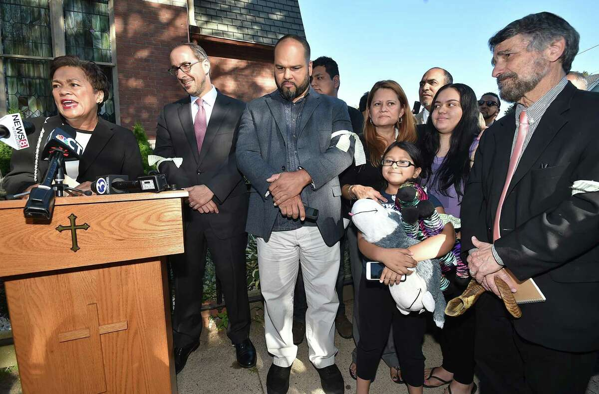 Mayor Toni N. Harp speaks to supporters of Nury Chavarria, who was on the verge of being deported back to Guatemala last week and has now been granted an emergency stay of that order, Wednesday, July 26, 2017. At right is Nury Chavarria with her two of her four children, Lindsay, 18 and 9-year-old Hayley Chavarri at Iglesia de Dios Pentecostal Church in the Fair Haven section of New Haven, Conn.