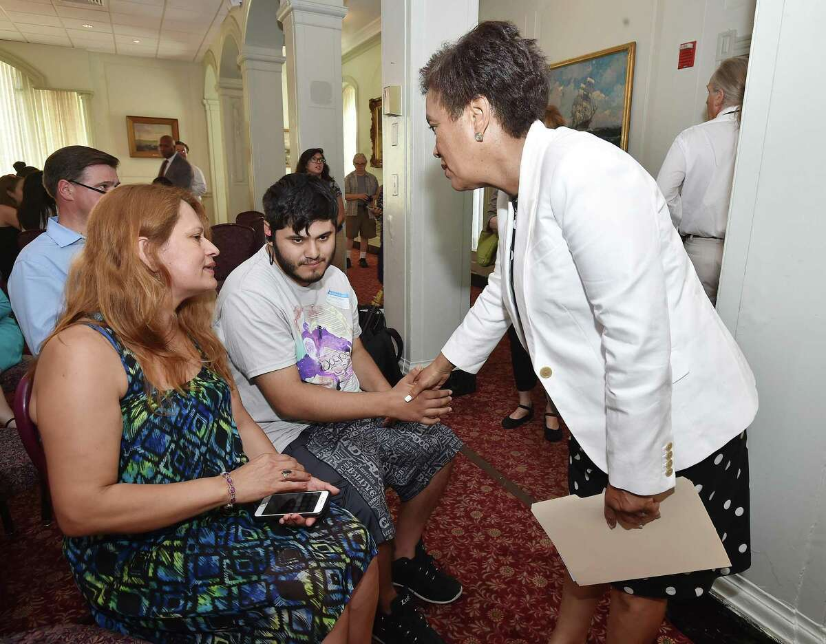 Mayor Toni N. Harp speaks with Norwalk resident Nury Chavarria, Wednesday, July 19, 2017, at the Quinnipiack Club on Church St. in New Haven. Chavarria is scheduled to be deported to Guatemala, Thursday, July 20, 2017. (Catherine Avalone ?- Hearst Connecticut Media)