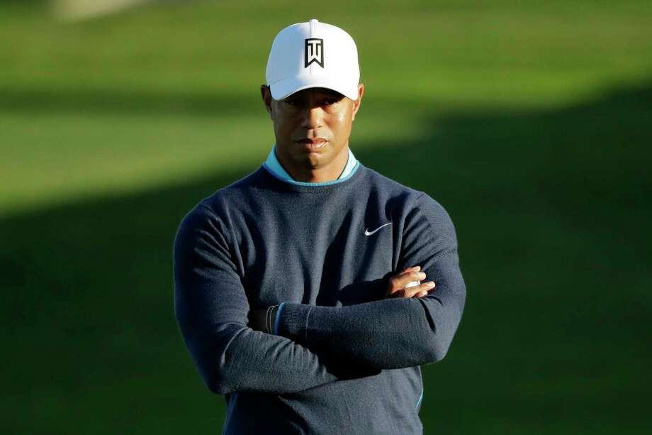 Tiger Woods waits to hit on the fifth hole of the north course at Torrey Pines Golf Course dduring the pro-am event at the Farmers Insurance Open golf tournament, Wednesday, Jan. 24, 2018, in San Diego. (AP Photo/Gregory Bull) Photo: Gregory Bull, STF / Copyright 2018 The Associated Press. All rights reserved.