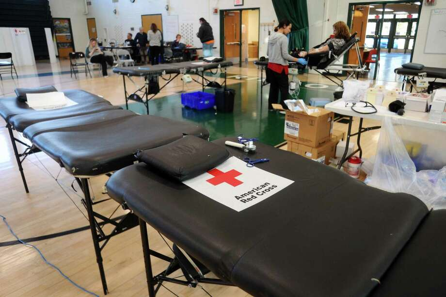 The American Red Cross hosted a blooddrive inside the Rippowam Middle School gymnasium in Stamford, Conn. on Wednesday, Jan. 24, 2018. The Red Cross said there is an urgent need for blood because the seasonal flu has contributed to a spike in canceled donations. Photo: Michael Cummo / Hearst Connecticut Media / Stamford Advocate