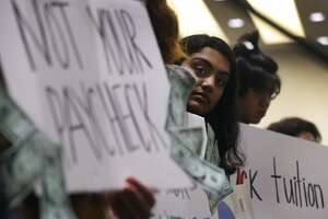 UC Berkeley student Nuha Khalfay listens to speakers address a meeting of the UC Board of Regents in San Francisco, Calif. on Wednesday, Jan. 24, 2018 where a tuition increase is being considered.
