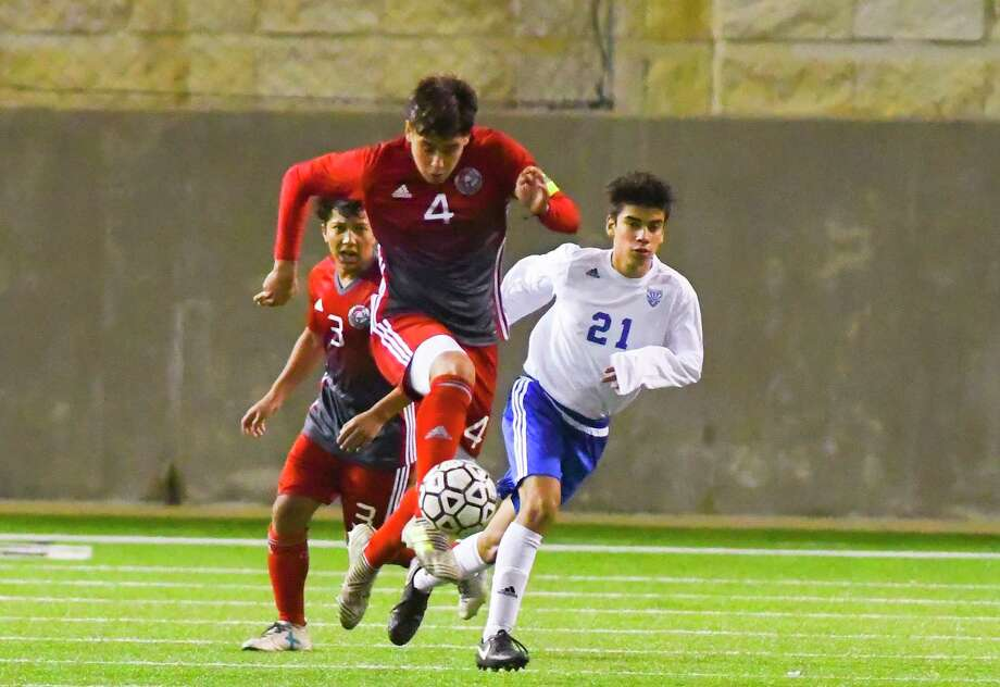 Cy Lakes' Ricky Aguilar kicks the ball down the field for the the Spartans. Photo: Tony Gaines/ HCN, Photographer