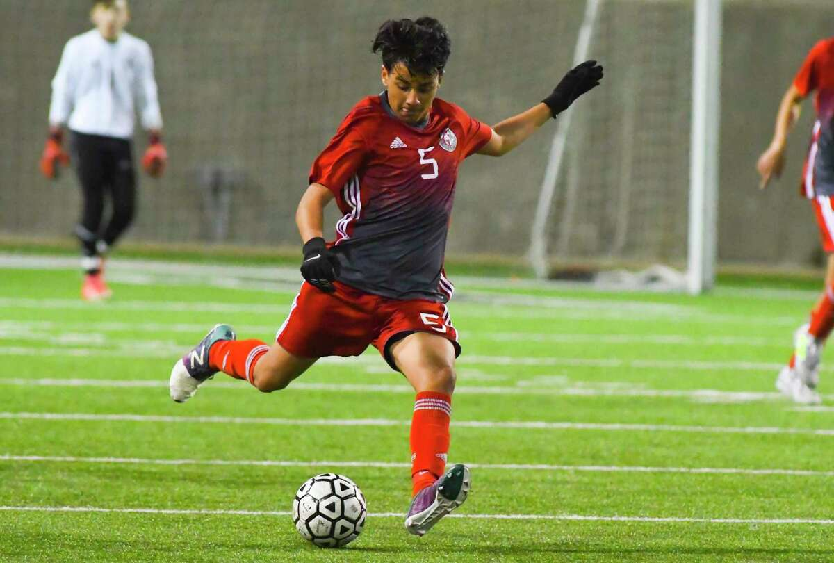Cy Lakes' Marcus Rangel kicks the ball down the field for the the Spartans.