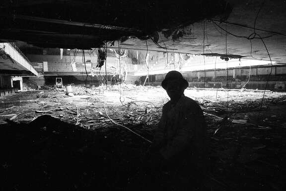 Sept. 17, 1985: A worker in the shadows looks at the interior of the Winterland Ballroom during its 1985 demolition.
