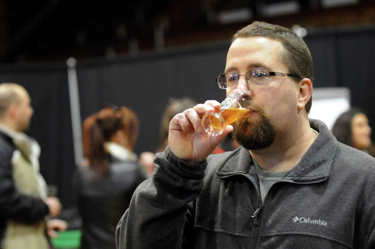 Kevin Buffaline of Troy drinks a craft beer during the Albany Winter Brewfest on Saturday, Feb. 8, 2014, at the Washington Avenue Armory in Albany, N.Y. (Cindy Schultz / Times Union)