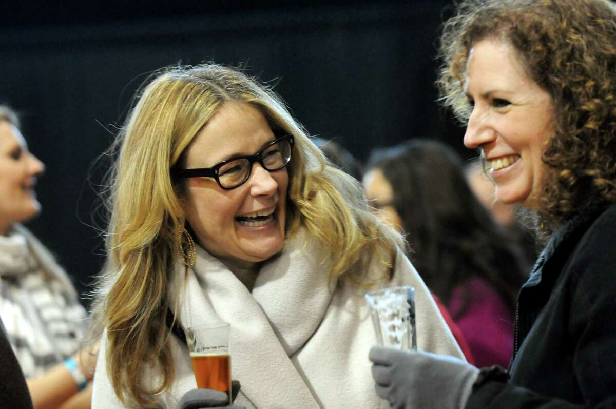 Maura Lilley, center, and Sandra Carrk, both of Delmar, enjoy the beer and the friendship during the Albany Winter Brewfest on Saturday, Feb. 8, 2014, at the Washington Avenue Armory in Albany, N.Y. (Cindy Schultz / Times Union)