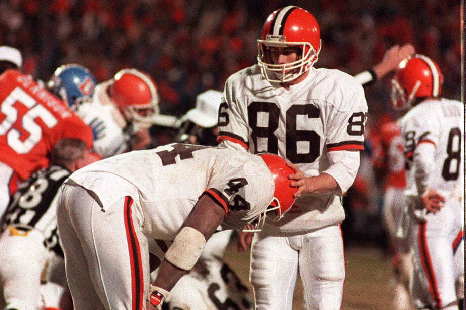 "The Browns and Earnest Byner, being comforted after ""The Fumble"" against the Broncos in the 1987 AFC Championship Game, dealt with more than their fair share of heartache. Photo: MARK DUNCAN/ASSOCIATED PRESS"
