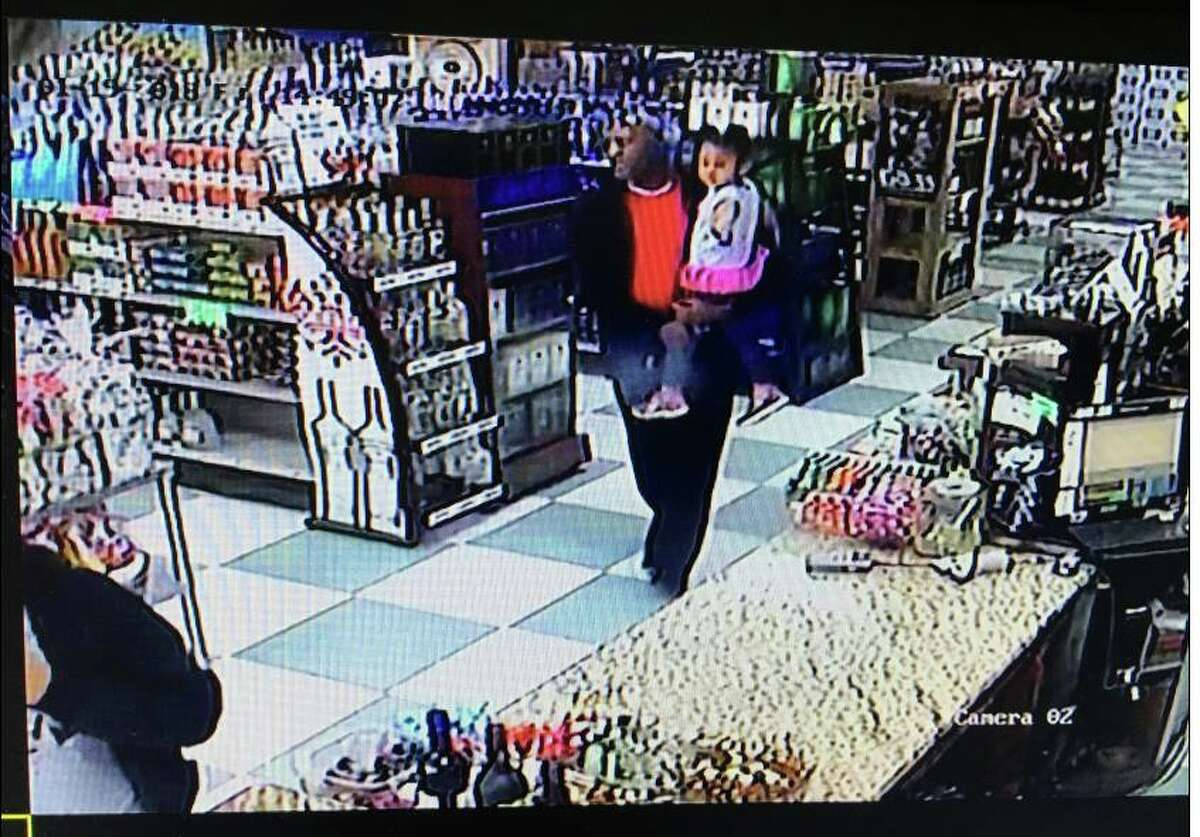 Police near Dallas are on the hunt for a man and woman accused of stealing a bottle of Hennessy from a liquor store Friday.