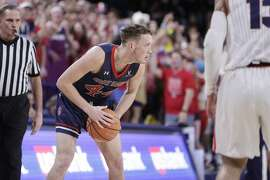 Saint Mary's guard Cullen Neal holds the ball during the second half of an NCAA college basketball game against Gonzaga in Spokane, Wash., Thursday, Jan. 18, 2018. (AP Photo/Young Kwak)