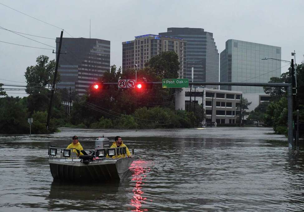 Rescue crews search for people in distress after Hurricane Harvey caused heavy flooding in Houston, Texas on August 27, 2017. Massive flooding unleashed by deadly monster storm Harvey left Houston -- the fourth-largest city in the United States -- increasingly isolated as its airports and highways shut down and residents fled homes waist-deep in water. / AFP PHOTO / MARK RALSTONMARK RALSTON/AFP/Getty Images ORG XMIT: Hurricane