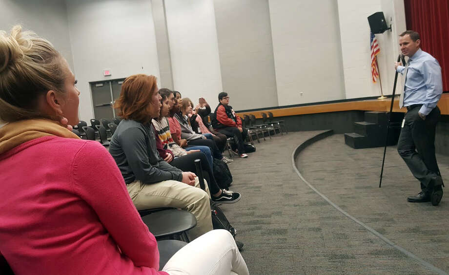 Hargrave High School teacher Julia Scull sits in the school teaching forum with her aquatics students as they listen to assistant superintendent Joel Nolte announce the winners of the pond design contest on Wednesday, Jan. 24. Photo: Melanie Feuk
