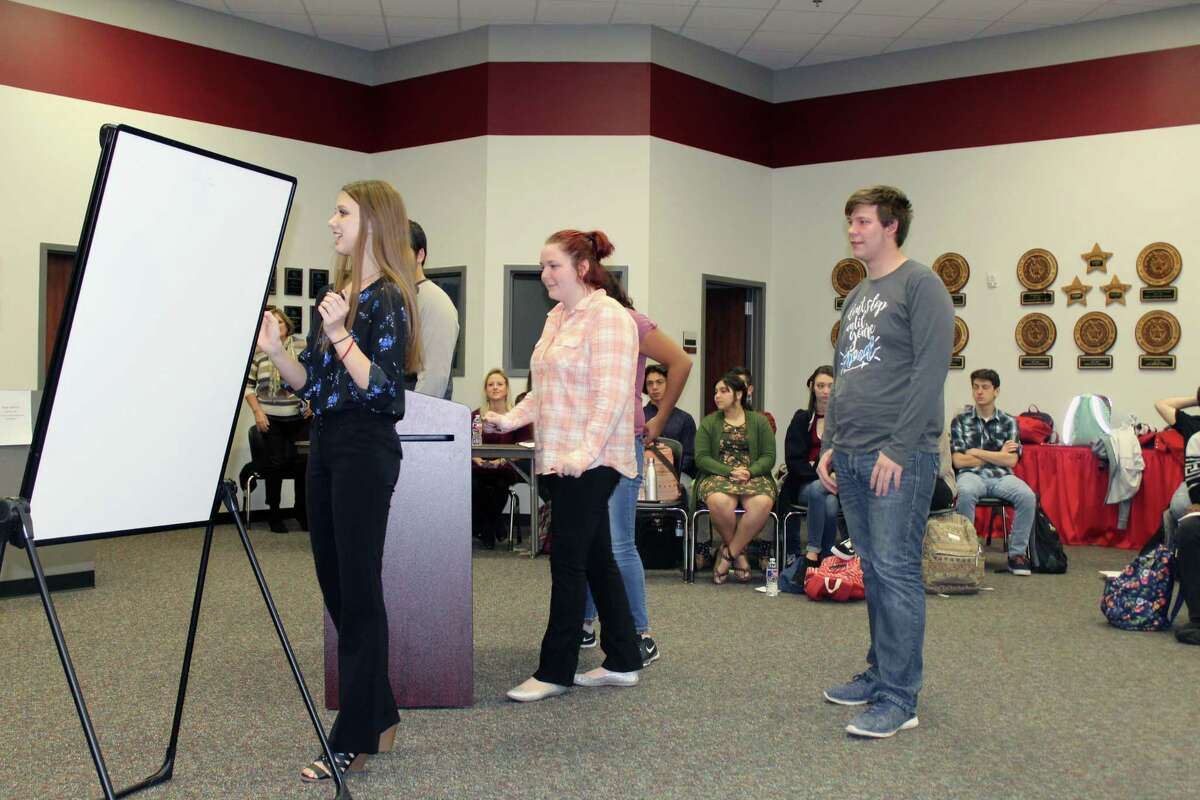Hargrave High School aquatics students present their pond design project at the Huffman ISD Administration Building on Friday, Jan. 19.