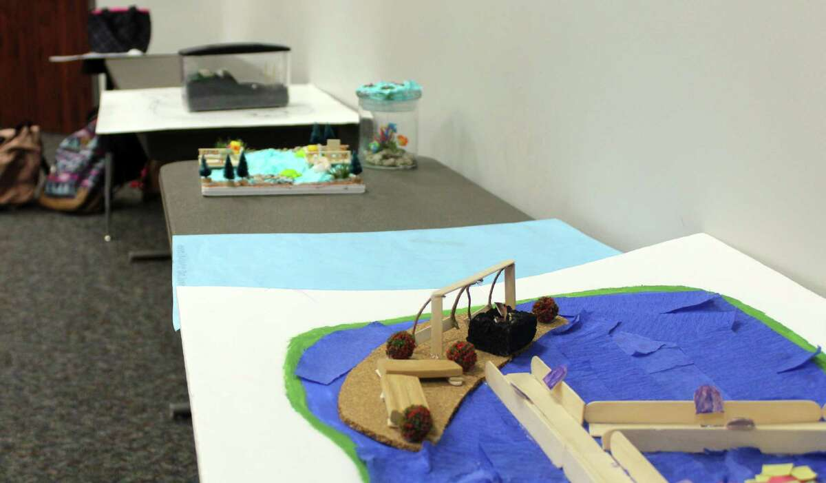 Models of Hargrave High School students' pond designs site on tables at the Huffman ISD Administration Building on Friday, Jan. 19.