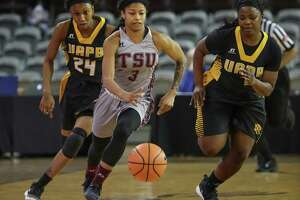 Texas Southern's Joyce Kennerson drives to the ball up court against Arkansas Pine Bluff's Noe'll Taylor (24) and guard Destiny Brewton (1) Monday, Jan. 22, 2018, in Houston. Kennerson is is the country's leading scorer. ( Steve Gonzales / Houston Chronicle )