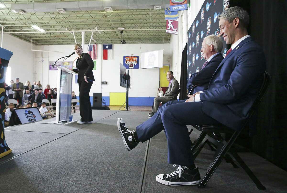 Mayor Ron Nirenberg kicks up his sneaker as leaders gather at Higgs Carter & King School gymnasium to announce key details for the NCAA Final Four Legacy Project on January 24, 2018.