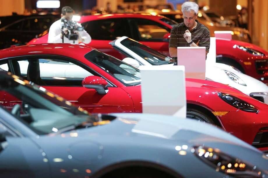 Phil Griffith looks at a Porsche during the first day of the Houston Auto Show at NRG Center Wednesday, Jan. 24, 2018 in Houston. ( Michael Ciaglo / Houston Chronicle) Photo: Michael Ciaglo, Houston Chronicle / Michael Ciaglo