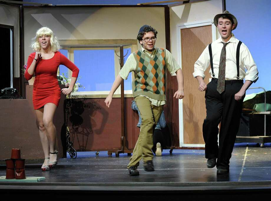 "From left, Diana Eileen Toland-Matos, Jake Ferris and Quentin Marcus rehearse a number from the musical ""Little Shop of Horrors.""  The play, directed by Anthony DePoto and musically directed by Erin Volpintesta is produced by era Productions in Bethel in conjunction with the Bethel Park and Recreation Department. Performances are this Friday and Saturday at Bethel High School. For more information 203-794-8531. Photo: Carol Kaliff / Hearst Connecticut Media / The News-Times"