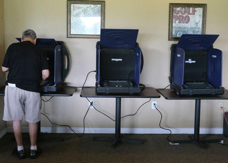 A man votes Tuesday, Nov. 7, 2017 at the Olmos Basin Golf Course in San Antonio. (John Davenport / San Antonio Express-News).