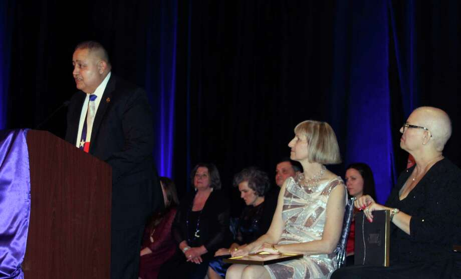 Capt. David Escobar, with the Harris County Pct. 4 Constable's Office, accepts the lifetime achievement award from FamilyTime Crisis and Counseling Center at the Hearts of Gold Gala on Saturday, Jan. 20. Photo: Julie Silva