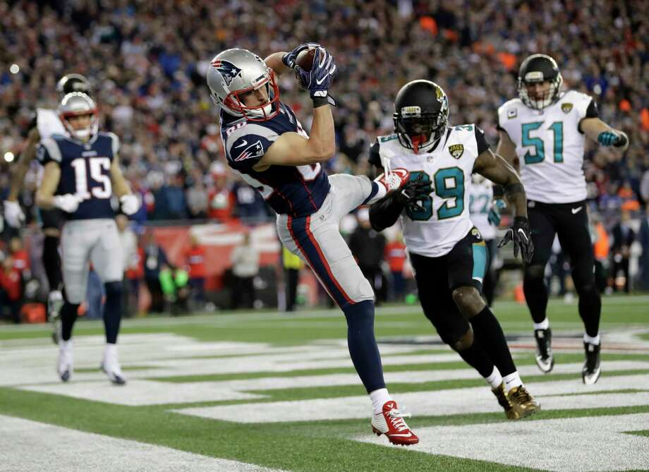 FILE - In this Sunday, Jan. 21, 2018, file photo, New England Patriots wide receiver Danny Amendola (80) catches a touchdown pass in front of Jacksonville Jaguars safety Tashaun Gipson (39) and linebacker Paul Posluszny (51) during the second half of the AFC championship NFL football game in Foxborough, Mass. Amendola has had a knack for producing in big moments in the playoffs the last two seasons. He had a touchdown catch and the tying 2-point conversion during New England's comeback win over Atlanta in last year's Super Bowl. And he was the recipient of two TD passes, including the winner, in its AFC title victory over Jacksonville. (AP Photo/David J. Phillip, File) Photo: David J. Phillip, STF / Copyright 2018 The Associated Press. All rights reserved.