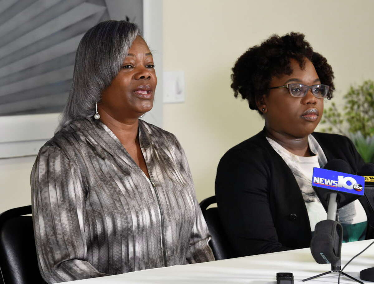 Gertha DePas, mother of Edson Thevenin who was shot by Troy Police Sgt. French, left is joined by her daughter in law Cinthia Thevenin as they spoke to the media during a press conference April 28, 2016 at the Empire Christian Center in Albany, N.Y. (Skip Dickstein/Times Union)