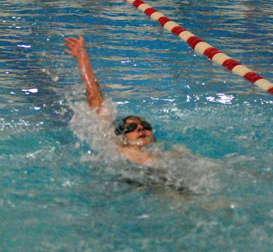 Action from the swim meet between Pomperaug and Weston on Wednesday. Photo: Ryan Lacey / Hearst Connecticut Media