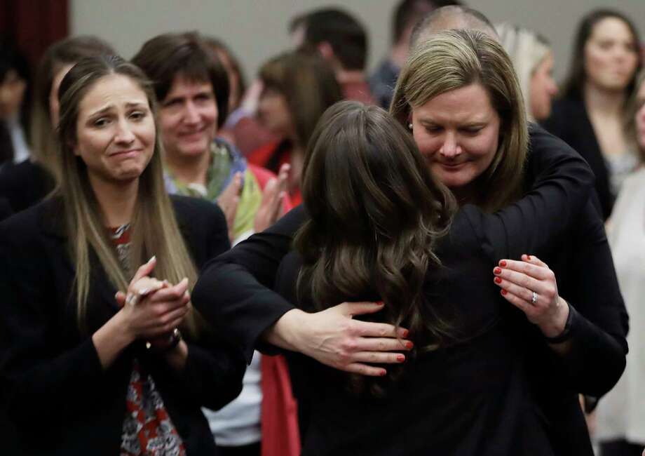 Victims react and hug Assistant Attorney General Angela Povilaitis after Larry Nassar was sentenced Wednesday. Nassar, employed by USA Gymnastics from the mid-1990s until 2015, pleaded guilty to seven counts of sexually assaulting athletes during his tenure. Photo: Carlos Osorio, STF / Copyright 2018 The Associated Press. All rights reserved.