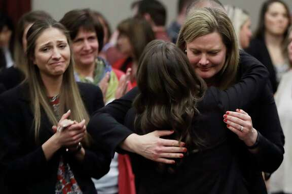 Victims react and hug Assistant Attorney General Angela Povilaitis after Larry Nassar was sentenced Wednesday. Nassar, employed by USA Gymnastics from the mid-1990s until 2015, pleaded guilty to seven counts of sexually assaulting athletes during his tenure.
