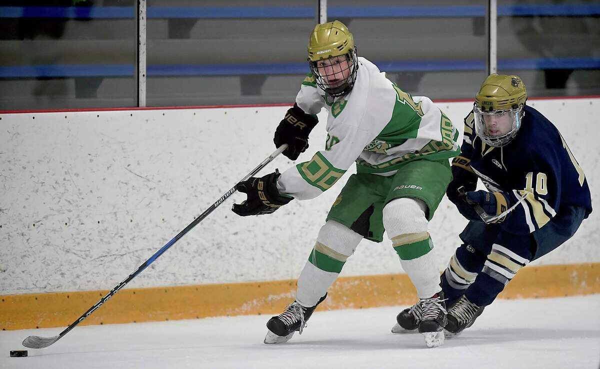 Notre Dame -West Haven sophomore forward Devin Napoli looks to make a pass as Notre Dame-Fairfield sophomore forward Aaron Martino defends, Wednesday, Jan. 24, 2018, at Bennett Rink in West Haven. Notre Dame-West Haven won, 5-0.