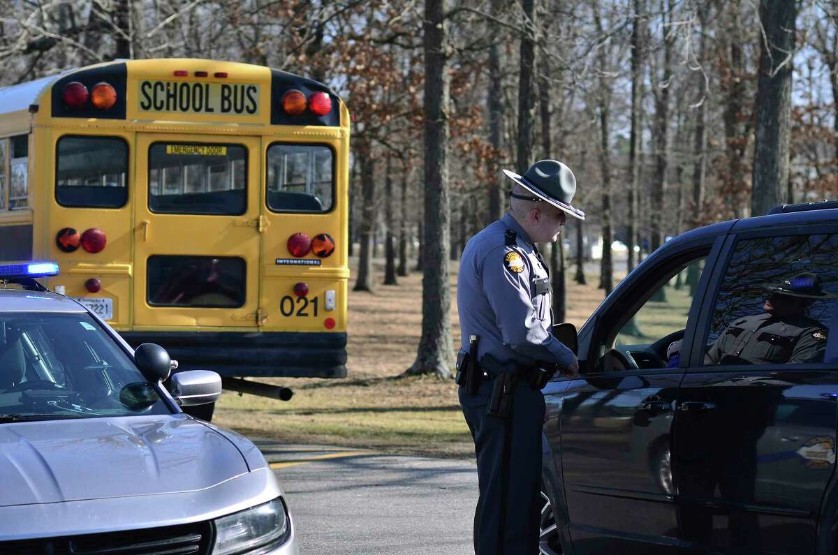 A Kentucky State Police trooper checks with a motorist entering Marshall County High School Wednesday, Jan. 24, 2018, near Benton, Ky. Two students died and another 18 people were injured in a shooting on Tuesday. (AP Photo/Stephen Lance Dennee)