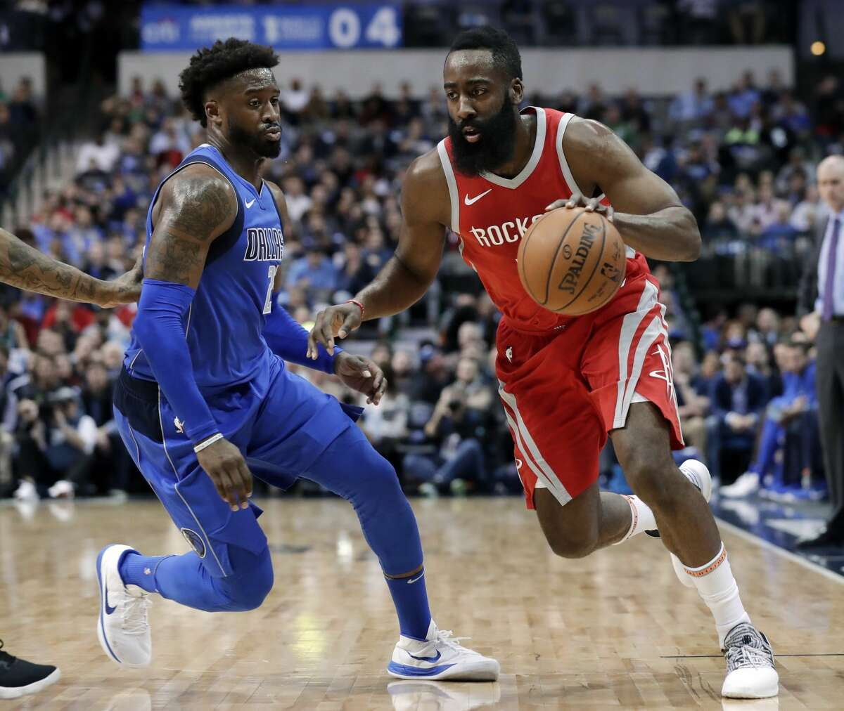 Dallas Mavericks guard Wesley Matthews (23) defends as Houston Rockets guard James Harden, right, advances the ball up court in the first half of an NBA basketball game Wednesday, Jan. 24, 2018, in Dallas. (AP Photo/Tony Gutierrez)