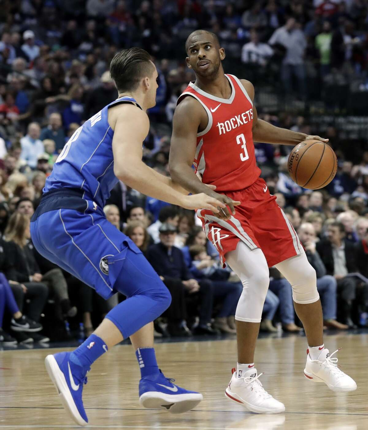 Dallas Mavericks guard Kyle Collinsworth (8) defends as Houston Rockets guard Chris Paul (3) handles the ball in the first half of an NBA basketball game Wednesday, Jan. 24, 2018, in Dallas. (AP Photo/Tony Gutierrez)