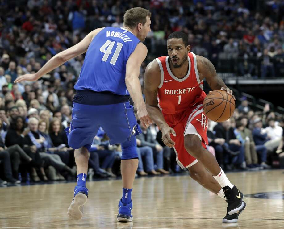 Rockets forward Trevor Ariza suffered a hamstring injury in Sunday's game against the Suns. It is not yet known how serious it is. Photo: Tony Gutierrez/Associated Press