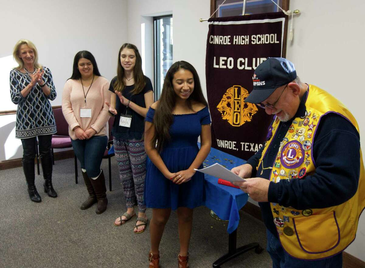 Kayleigh Martinez, president of the Conroe High School LEO Club, shares a laugh with Eddie Risha as officers are sworn in during a meeting Wednesday, Jan. 24, 2018, in Conroe. Members of the Conroe Noon Lions Club were on hand to help guide the new high school club.