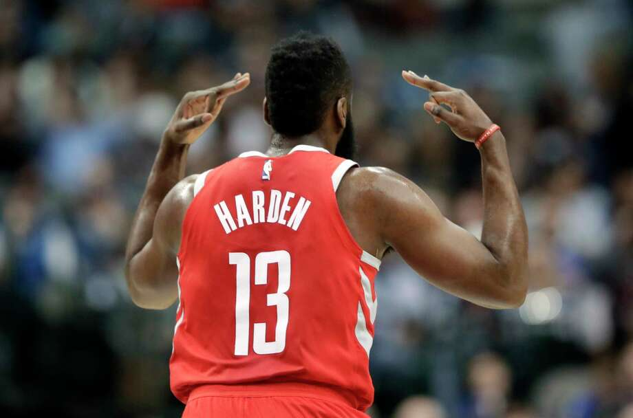 Houston Rockets guard James Harden (13) celebrates sinking a three-point basket in the first half of an NBA basketball game against the Dallas Mavericks on Wednesday, Jan. 24, 2018, in Dallas. (AP Photo/Tony Gutierrez) Photo: Tony Gutierrez, STF / Copyright 2018 The Associated Press. All rights reserved.