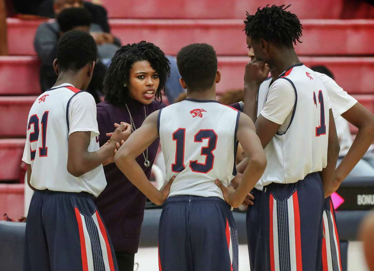 """Cypress Springs freshman boys basketball coach Mansa El gets her point across in leading the Panthers to victory Tuesday. Cypress Springs varsity coach Sam Benitez calls El """"the real deal."""""""