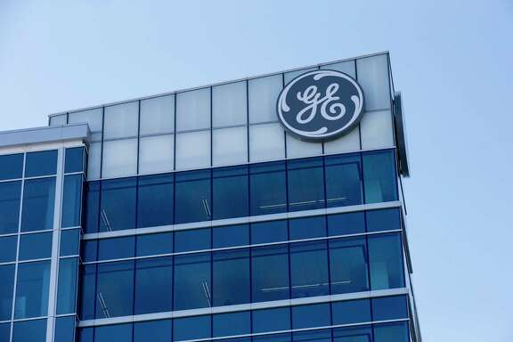 In this Tuesday, Jan. 16, 2018, photo, the General Electric logo is displayed at the top of their Global Operations Center in the Banks development of downtown Cincinnati. General Electric Co. reports earnings, Wednesday, Jan. 24, 2018. (AP Photo/John Minchillo)