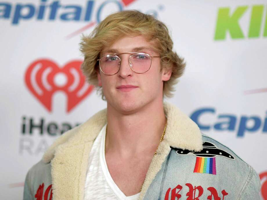 """In this Dec. 1, 2017 file photo, YouTube personality Logan Paul arrives at Jingle Ball in Inglewood, Calif. Paul has returned to YouTube with a 7-minute suicide prevention video he hopes will """"make a difference in the world."""" He was suspended by YouTube after posting video of him in a forest in Japan near what seemed to be a body hanging from a tree. The location is known in Japan as a frequent site for suicides. (Photo by Richard Shotwell/Invision/AP, File) Photo: Richard Shotwell / 2017 Invision"""