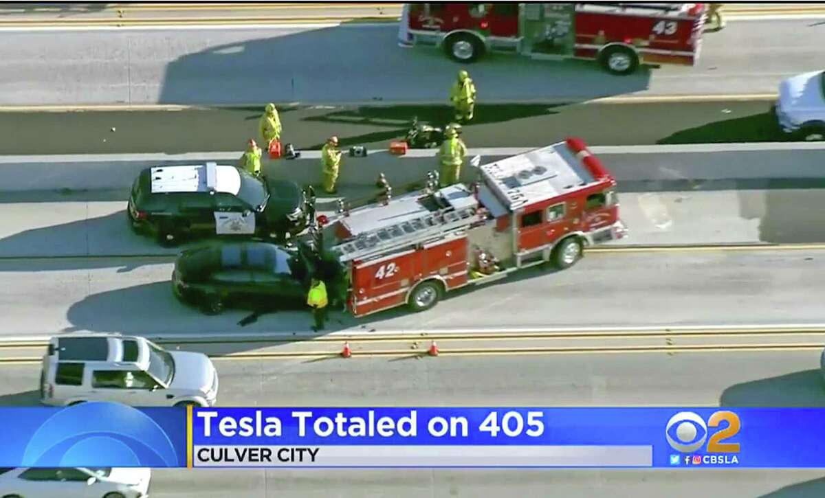 This Monday, Jan. 22, 2018 still frame from video provided by KCBS-TV shows a Tesla Model S electric car that has crashed into a fire engine on Interstate 405 in Culver City, Calif. Two federal agencies have dispatched teams to investigate the crash of the car that may have been operating under its semi-autonomous