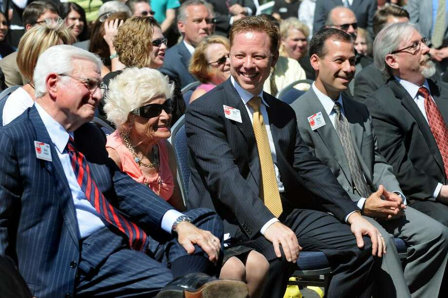 The Golub family enjoys the moment as they listen to speakers at the dedication ceremony of the new Golub headquarters on Wednesday in Schenectady. From left are Neil Golub, his wife, Jane, and nephews Jerry, president and COO, and David, vice president of administration. (Cindy Schultz / Times Union) Photo: CINDY SCHULTZ