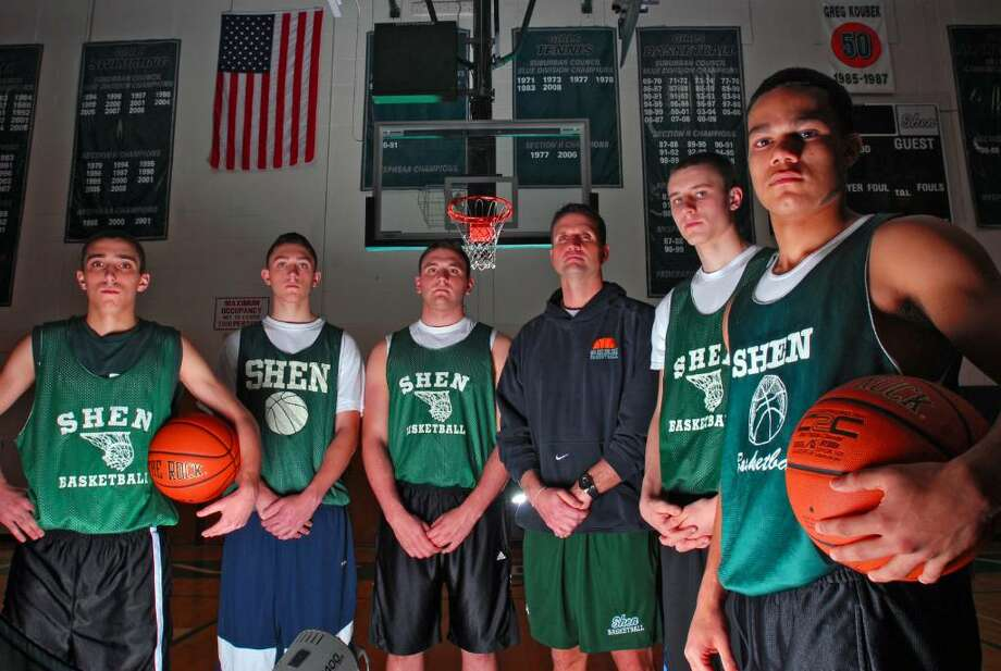 Shenendehowa High School boys basketball players, from left, Justin Barnett, Matt Miner, Josh Koopman, coach Tony Dzikas, Dan Lee and Jose Reyes are preparing for the upcoming season. (Philip Kamrass /  Times Union) Photo: PHILIP KAMRASS / 00006682A